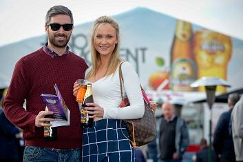 Woman with pint bottle of Bulmers
